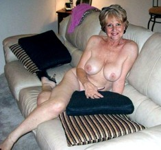Beautiful and almost naked mature lady..