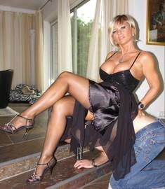 Mature women in stockings in various..