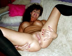 I like her nice smile and wet old pussy