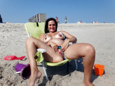 Mature nudists sunbathes on the free..