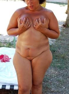 Nude Plump granny sunning on the beach