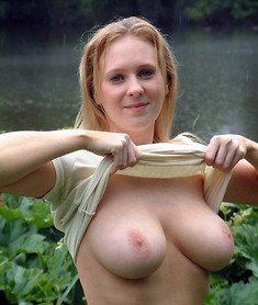 Busty MILF with heavy breasts and lush..