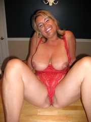 Naked mature BBW posing on the long heels,...